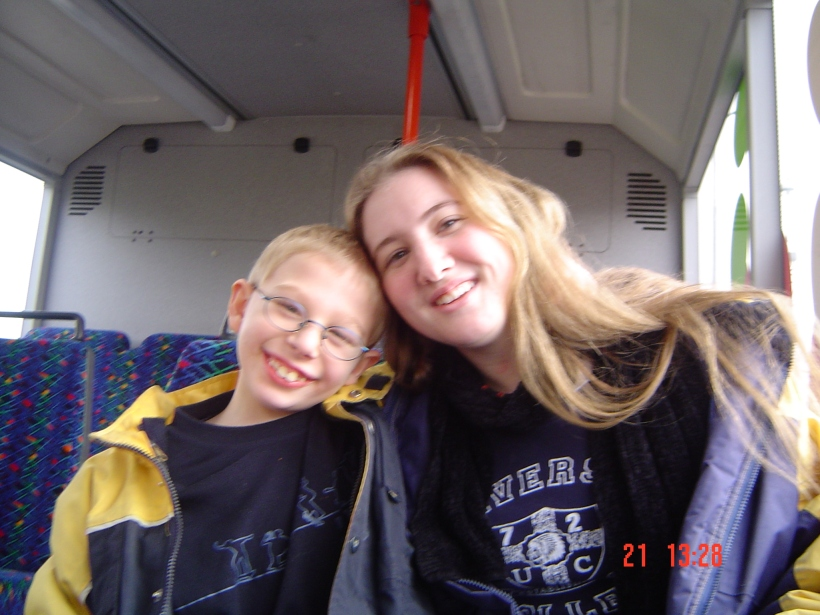 With his big sister, in 2002